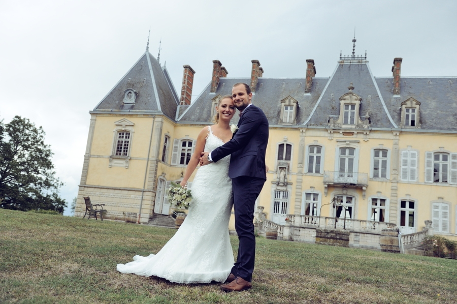 Bride and Groom in front of a castle in the east of France near Swizerland .